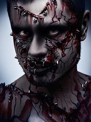 A creepy halloween concept of a dark angry moor with a peircing and bloody body art.